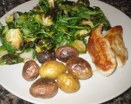 Roasted Brussels Sprouts and Arugula Side Salad on the Plate