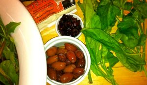 Ingredients for Salad with Goat Cheese, Cranberries, and Kalamata Olives.