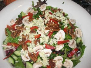 Salad with Blue Cheese, Candied Pecans, and the Kitchen Sink